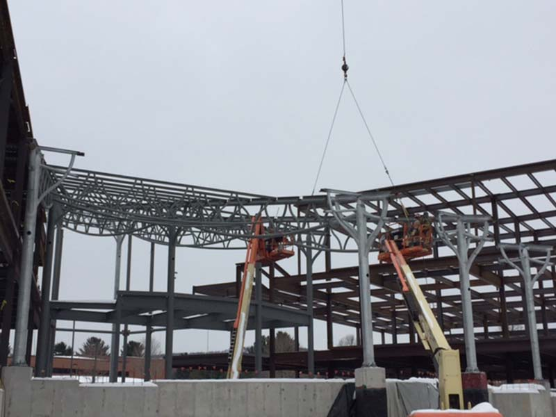 Workers putting up Steel trusses