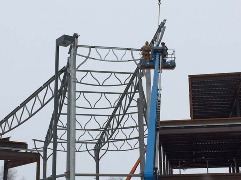 Workers putting up Steel trusses during construction
