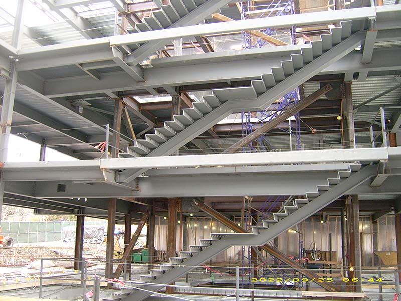 Stairs on each floor of steel frame builing