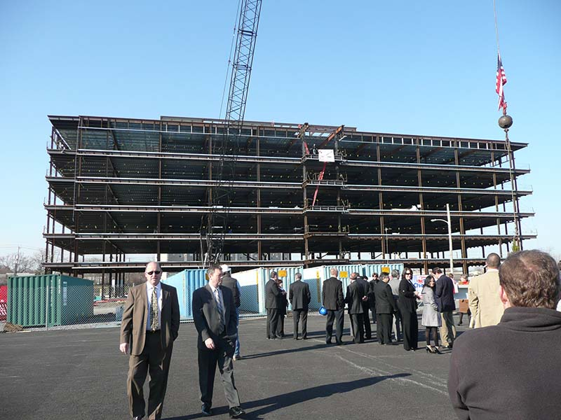 6 story building being built with steel beams