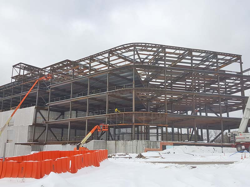 4 story building being built of Steel I-Beams