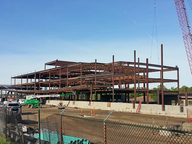 Steel I-Beams being erected on construction site
